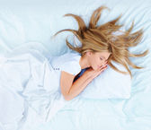 Woman on the bed — Stock Photo