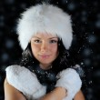 Beautiful woman in a winter hat — Stock Photo #10950921