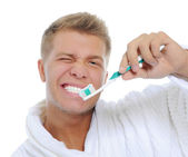 Man brushing his teeth — Stock Photo