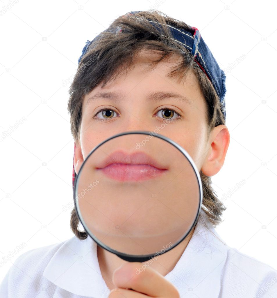 Beautiful boy looking through a magnifying glass isolated on a white background — Stock Photo #10950812