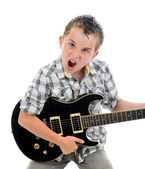 Little musician playing guitar — Stock Photo