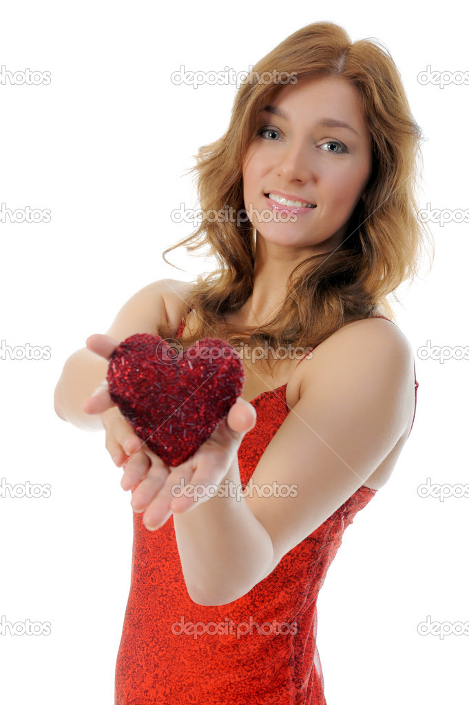 Attractive young woman holding a heart. isolated on white background.  Stock Photo #10982375