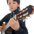 trochę chłopiec muzyk grający na gitarze — Zdjęcie stockowe