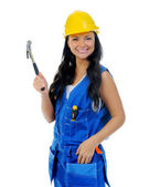 Beautiful young woman doing repairs — Stock Photo