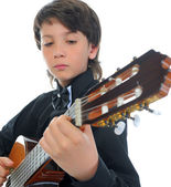 Little boy musician playing guitar — Stock Photo