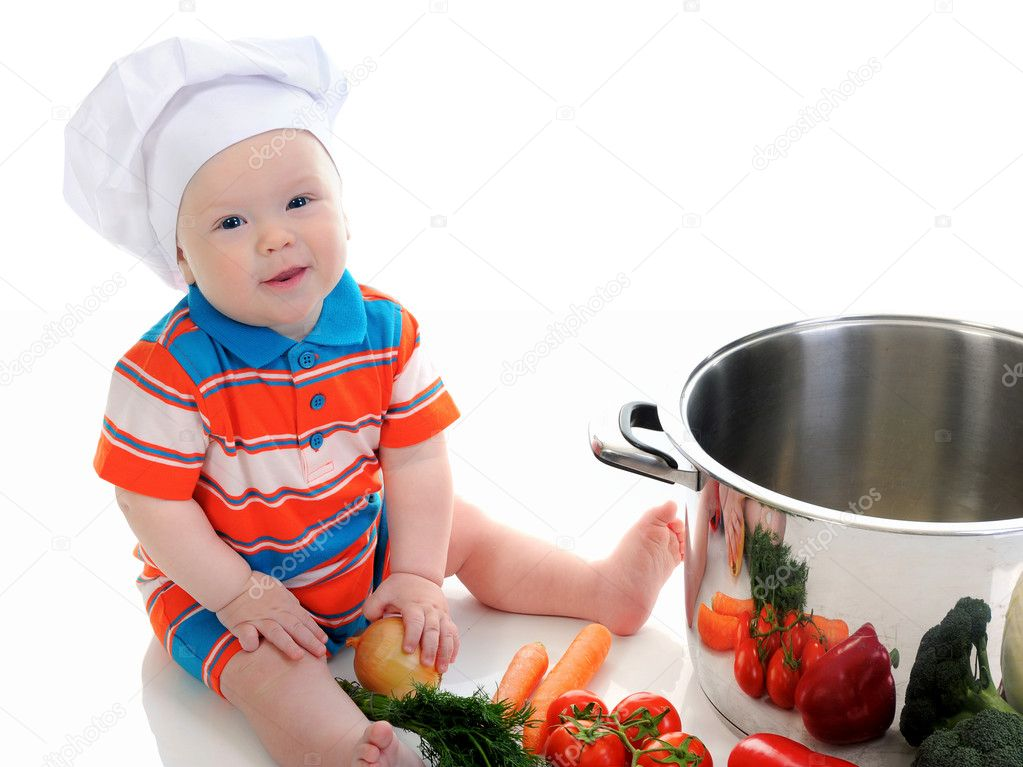 Little boy in a suit of the cook in the kitchen preparing soup. Isolated on white background — Stock Photo #11089489