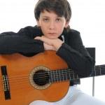 Little boy musician playing guitar — Stock Photo