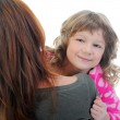 Cheerful girl hugs her young mother. — Stock Photo #11115103