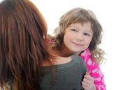 Cheerful girl hugs her young mother. — Stock Photo