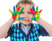 Smiling boy with the palms painted by a paint. — Stock Photo