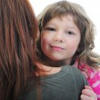 Cheerful girl hugs her young mother. — Stock Photo #11128264