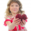 Little girl holding heart — Stock Photo