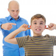 Strict father punishes his son - Stock Photo