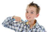 Hermoso niño limpia los dientes — Foto de Stock