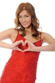 žena držící srdce — Stock fotografie