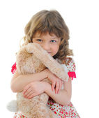 Little girl with toy hare. — Stock Photo