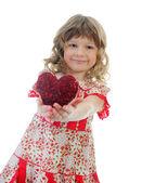 Little girl holding heart — Photo