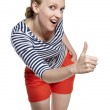 Portrait of a young woman showing thumbs up — Stock Photo #11518475