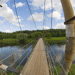 Suspension Bridge over the River — Stock Photo
