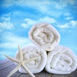 Fluffy fresh towels against a blue sky — Stock Photo