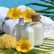 Spa products and towels by the pool - Stock Photo