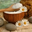 Spa still life with bath salts and daisies - Stock Photo
