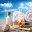 Towels with bath accessories at the beach — Stock Photo