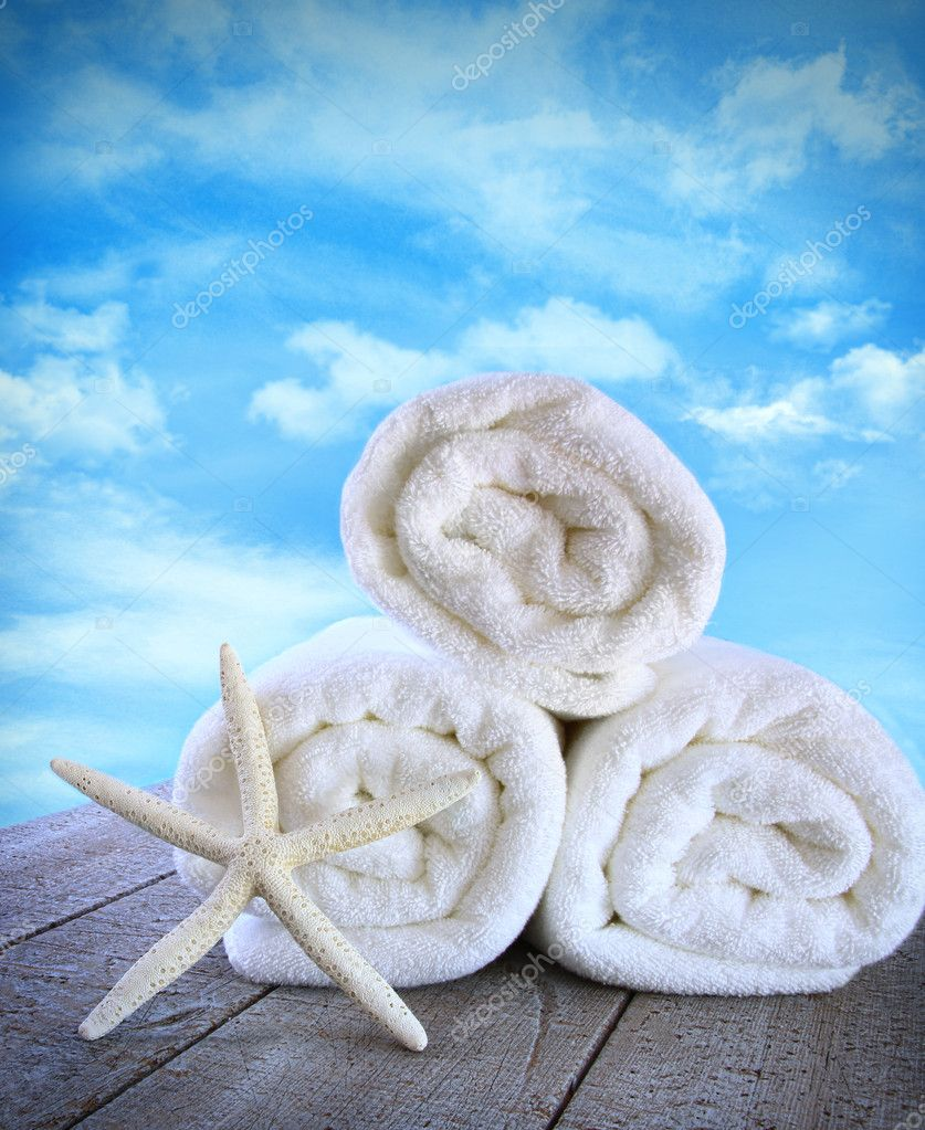 Fluffy fresh towels against a blue sky with clouds  Stock Photo #11116334