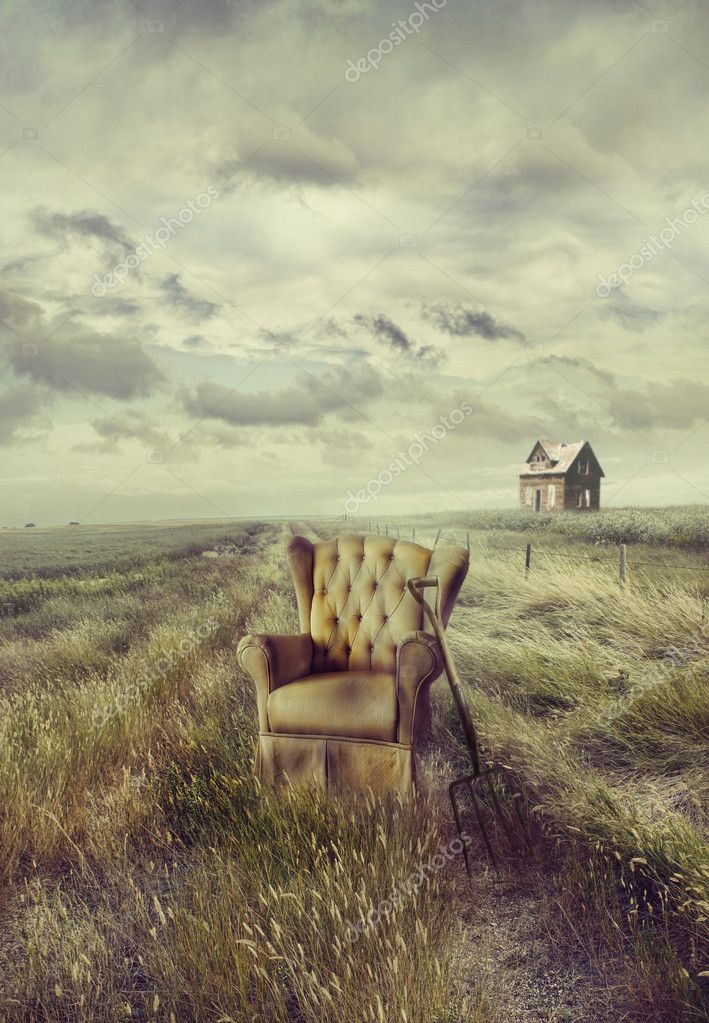 Old sofa chair in tall grass on prairie path — Stock Photo #11116581