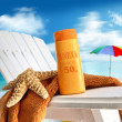Suntan lotion on chair at the  beach - Stock Photo