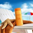 Suntan lotion on chair at the beach — Stock Photo