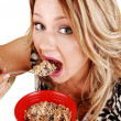 Royalty-Free Stock Photo: Hungry girl eating.
