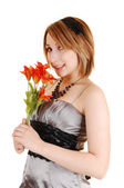 Pretty girl with flowers. — Stock Photo