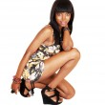 African girl crouching. — Stock Photo