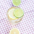 Water with lemon and lime in a glass with ice — Stock Photo