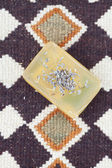 Lavender and soap on ethnic mat — Stockfoto