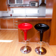 Kitchen interior with bar chairs in the apartment — Stock Photo #10809486