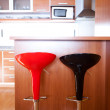 Stock Photo: Kitchen interior with bar chairs in the apartment