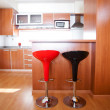 Kitchen interior with bar chairs in the apartment — Stock Photo #10809503