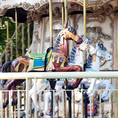 Old carousel with horses — Stock Photo