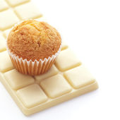 Bar of white chocolate and muffin isolated on white — Stock Photo