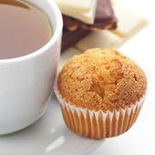 Bar of chocolate,tea and muffin isolated on white — Stock Photo