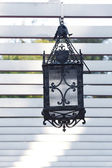 Decorative lantern hanging in the arbor — Stock Photo