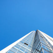 Beautiful modern office building against the blue sky — Stock Photo