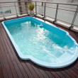 Blue swimming pool on the roof — Stock Photo