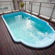 Blue swimming pool on the roof — Stock Photo #11126885