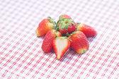 Strawberry lying on plaid fabric — Stock Photo