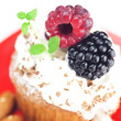 Muffin with whipped cream,mint, raspberries, blackberries and nu — Stock Photo #11927833