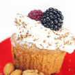 Muffin with whipped cream,mint, raspberries, blackberries and nu - Stock Photo