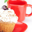 Muffin with whipped cream, cherries and red cup on white backgro — Stock Photo #11977377
